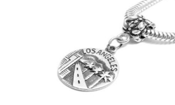 Embossed Charm manufacturer and supplier in China
